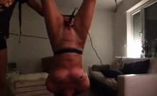 my slave Andrea dangling upside down
