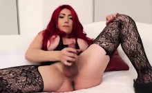 Hot redhead shemale with massive tits solo plays on a bed