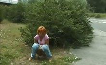 Dame peeing outdoors