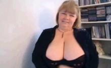 Mom Carla brandishing huge tits on webcam