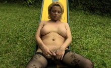Daring blonde tbabe reveals big breasts in public playground