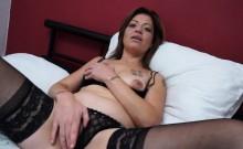 Kinky mature lady masturbates in stockings
