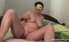 Mature horny BBW finger fucking her hungry snatch in bed