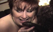 Two mature busty Brits share a big black cock together