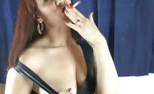 Brunette babe posing sexy while smoking