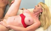 Busty blonde milf in high heels engages in hot sex with a younger guy