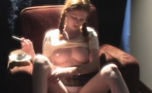 Big tit redhead smokes while showing her boobs and fingerin