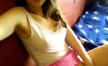 Pretty teen with small tits fingering on webcam
