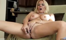 Kara Nox reveals and masturbates her shaved pussy in an