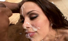 Assfucked beauty facialized during interracial sex